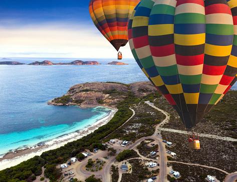 istock Hot air balloon with Car camping in holiday at Happy bay beach 1151564672