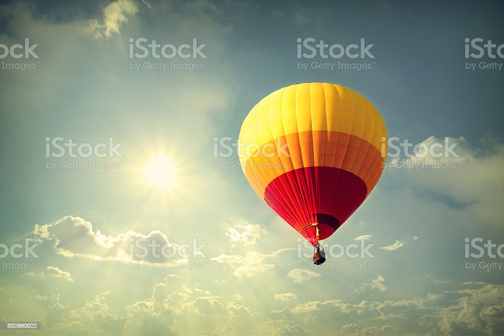 Hot air balloon on sky with cloud, vintage retro filter effect