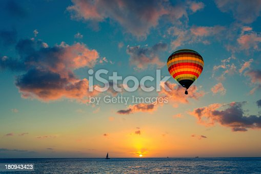 istock Hot air balloon with sunset at the sea background 180943423