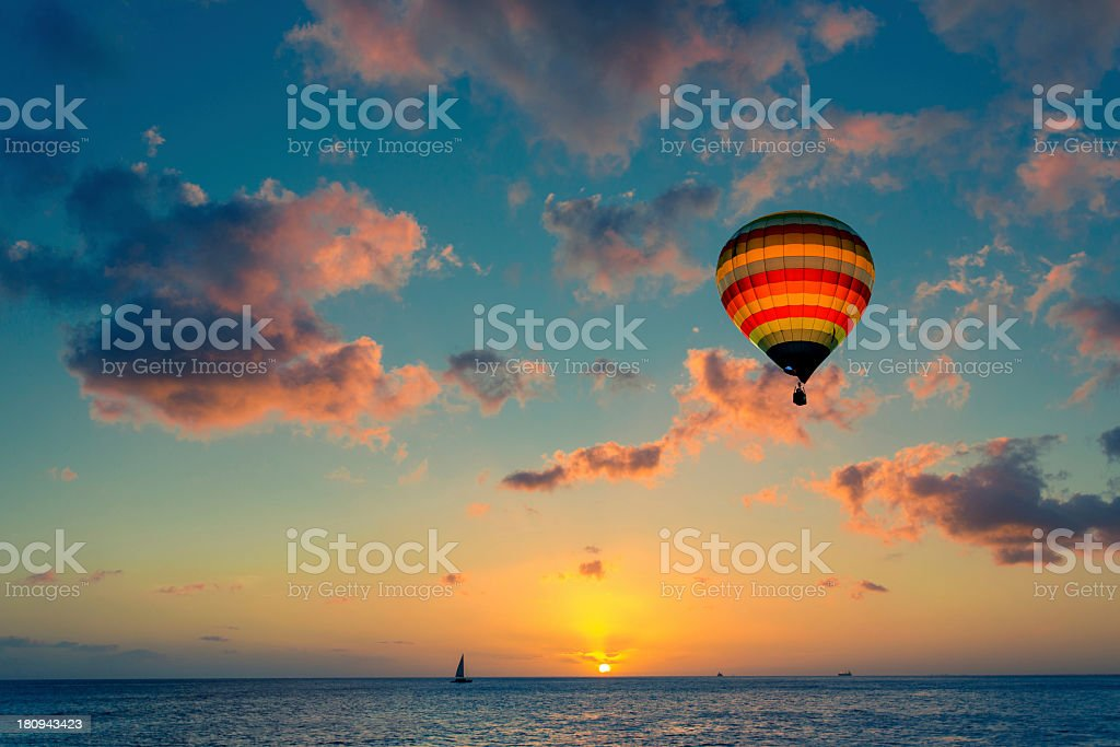 Hot air balloon with sunset at the sea background stock photo