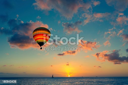 istock Hot air balloon with sunset at the sea background 180943426
