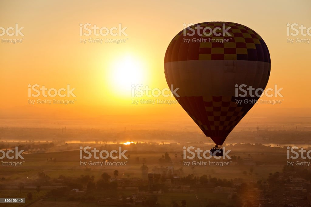 Hot air ballooning in Luxor over the Valley of the Kings and Nile river. stock photo