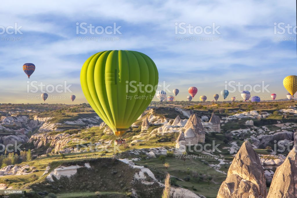 Hot air balloons at sunset over the valley of love, Cappadocia, Turkey