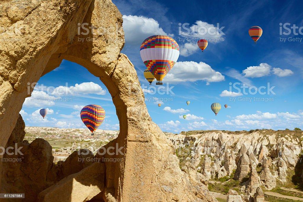 Hot air balloons flies in blue sky in Kapadokya, Turkey stock photo