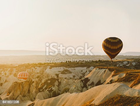 Hot air balloons rising up during sunrise at Cappadocia, Turkey. (Hasselblad/ISO100)