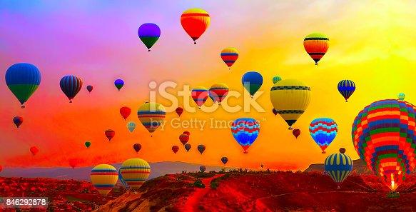 844061492 istock photo hot air balloons flight sunrise 846292878