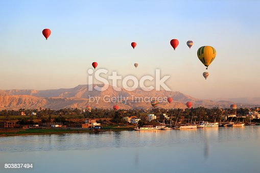 istock Hot air balloons floating over the Nile River in Luxor at sunrise 803837494