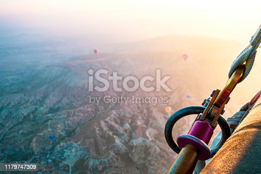 515376634 istock photo Hot air balloons flying at dawn over the valley of Cappadocia in Turkey. View from a basket. 1179747309