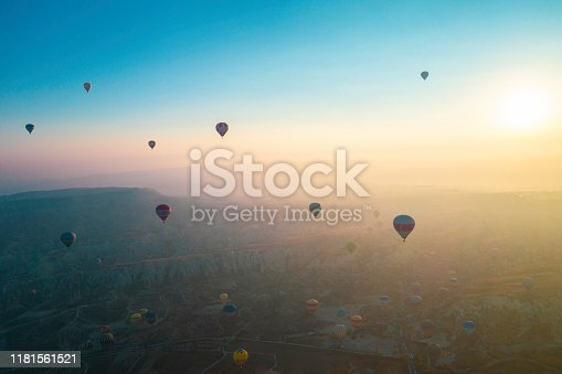 515376634 istock photo Hot air balloons flying at dawn over the valley of Cappadocia in Turkey. 1181561521