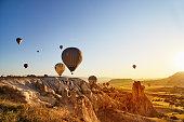 istock Hot Air Balloons Flying at Sunset, Cappadocia, Turkey 974274074