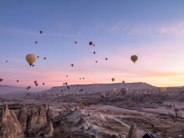 Hot air balloons flying in red and rose valley in Goreme in Cappadocia in Turkey Cappadocia, Hot Air Balloon, red and rose valley, Famous Place, Turkey - Middle East 4k resolution stock pictures, royalty-free photos & images