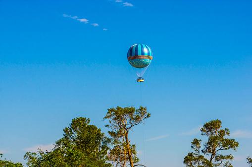 Hot air balloons flying on the blue sky at Orlando, Florida, USA