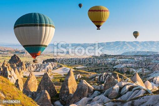 istock Hot air balloons flying over Cappadocia, Turkey 944580634