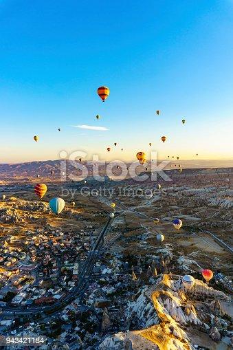 istock Hot air balloons flying over spectacular Cappadocia 943421184