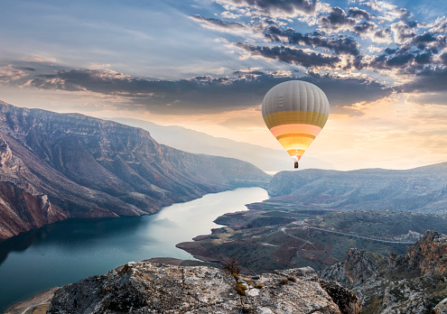 Hot air balloons flying over the Botan Canyon in TURKEY