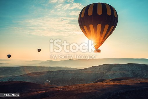 istock Hot air balloons flying over the valley at Cappadocia, Turkey 926425076