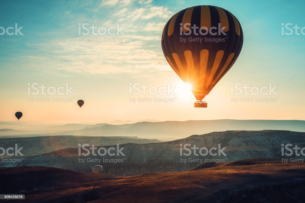 Hot air balloons flying over the valley at Cappadocia, Turkey stock photo