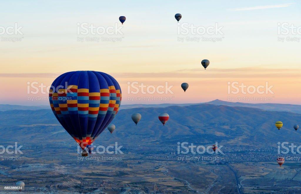 Hot air balloons flying over valley at sunrise. Cappadocia. Turkey royalty-free stock photo