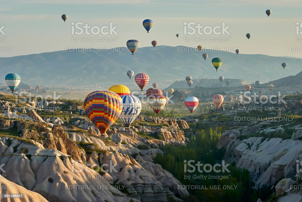 Hot air balloons flying over valley in the morning. Cappadocia. Turkey stock photo
