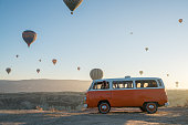 Cappadocia,Türkey - December 02, 2017:Hot air balloons flying over valley in the morning and people camping in Cappadocia. Turkey
