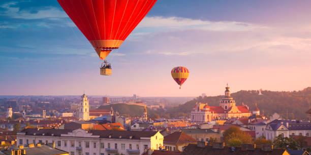 Hot air balloons flying over Vilnius stock photo