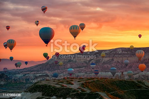 515376634 istock photo Hot Air balloons flying tour over Mountains landscape spring sunrice Cappadocia, Goreme Open Air Museum National Park, Turkey nature background. 1142966438