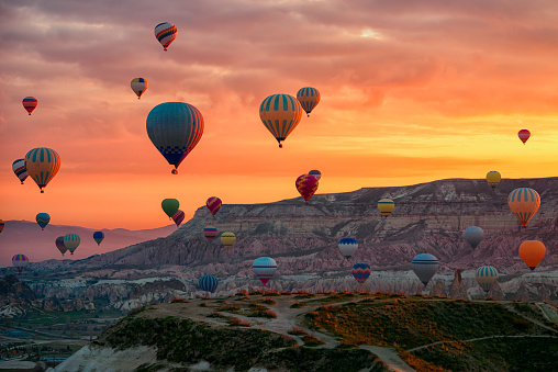 istock Hot Air balloons flying tour over Mountains landscape spring sunrice Cappadocia, Goreme Open Air Museum National Park, Turkey nature background. 1142966438