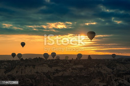 515376634 istock photo Hot Air balloons flying tour over Mountains landscape spring sunrise Cappadocia, Goreme Open Air Museum National Park, Turkey nature background. 1144722853