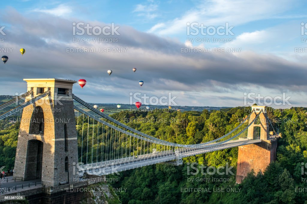 Hot Air Balloons from the Bristol Balloon Fiesta fly past Clifton Suspension Bridge stock photo