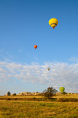 Colorful hot air balloons flying over the Göreme valley in Cappadocia, Turkey