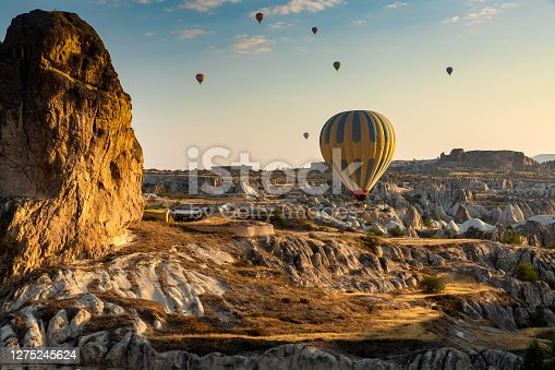 Hot air balloons in Cappadocia with rock formation