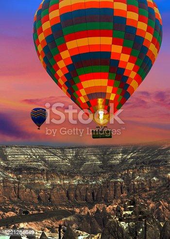 844061492 istock photo Hot air balloons landing in a mountain Cappadocia Goreme National Park Turkey. 1221284649