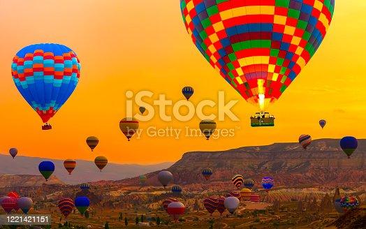 844061492 istock photo Hot air balloons landing mountain Tourists ride 1221421151