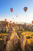 Hot air ballons over Love Valley near Goreme and Nevsehir in the center of Cappadocia, Turkey (region of Anatolia). This shot taken shortly after sunrise.