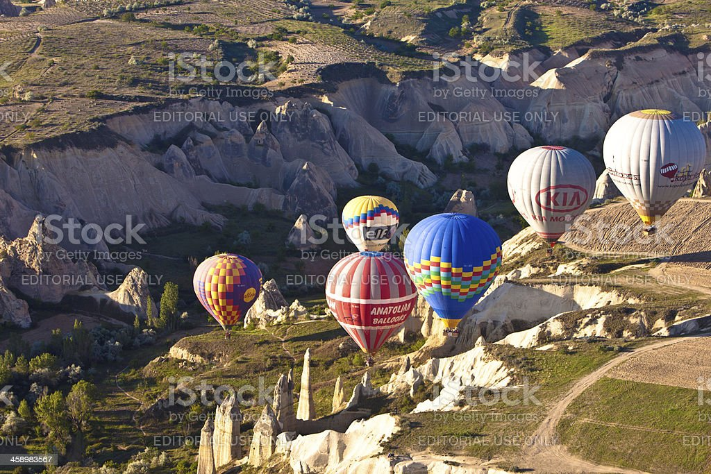 \'Goreme, Turkey - May 18, 2012: Hot air balloons floating over Love...