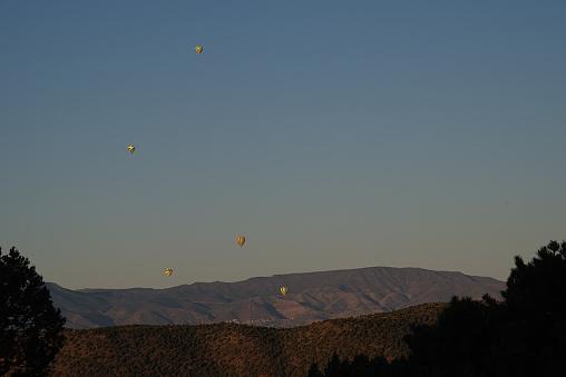 hot air balloons rising over Sedona, Arizona at sunrise