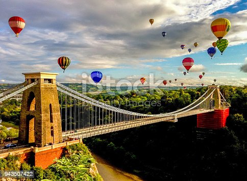 Bristol international balloon fiesta is an annual event. The balloons are flying over Clifton suspension bridge.