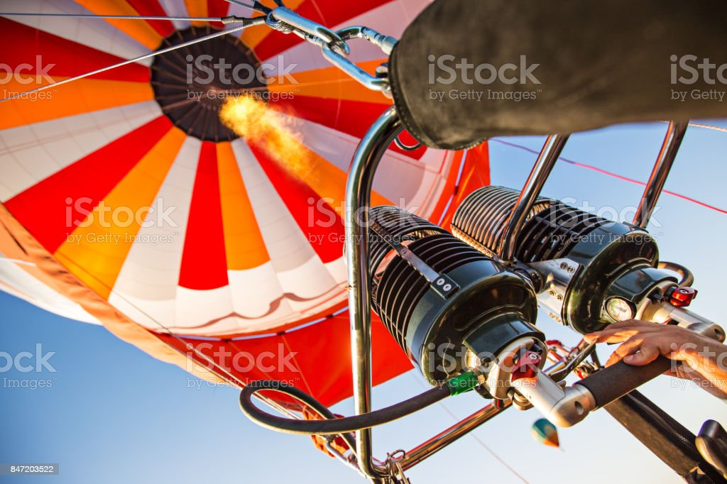 A hot air baloon rising high. Unusual perspective view stock photo