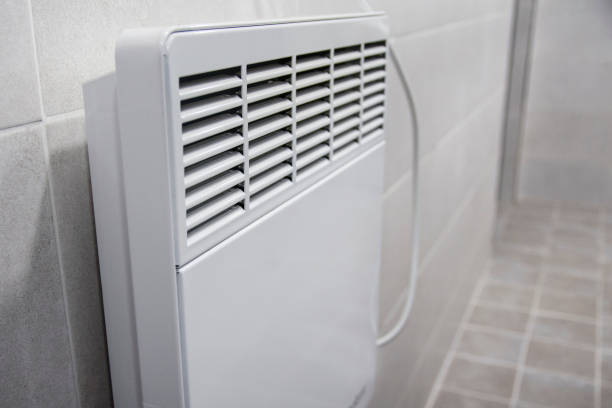 Hot air heater installed in public toilet stock photo