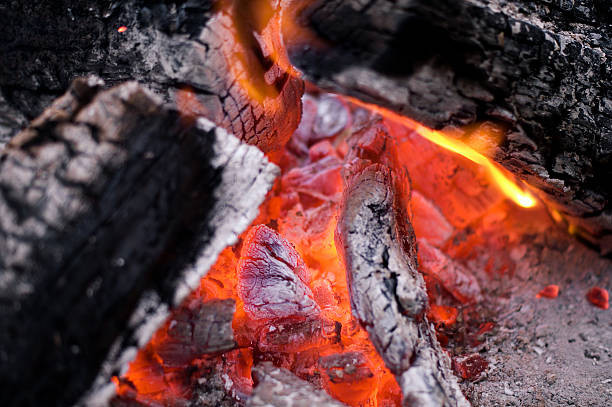 Hot and glowing coals of a softly-burning fire stock photo