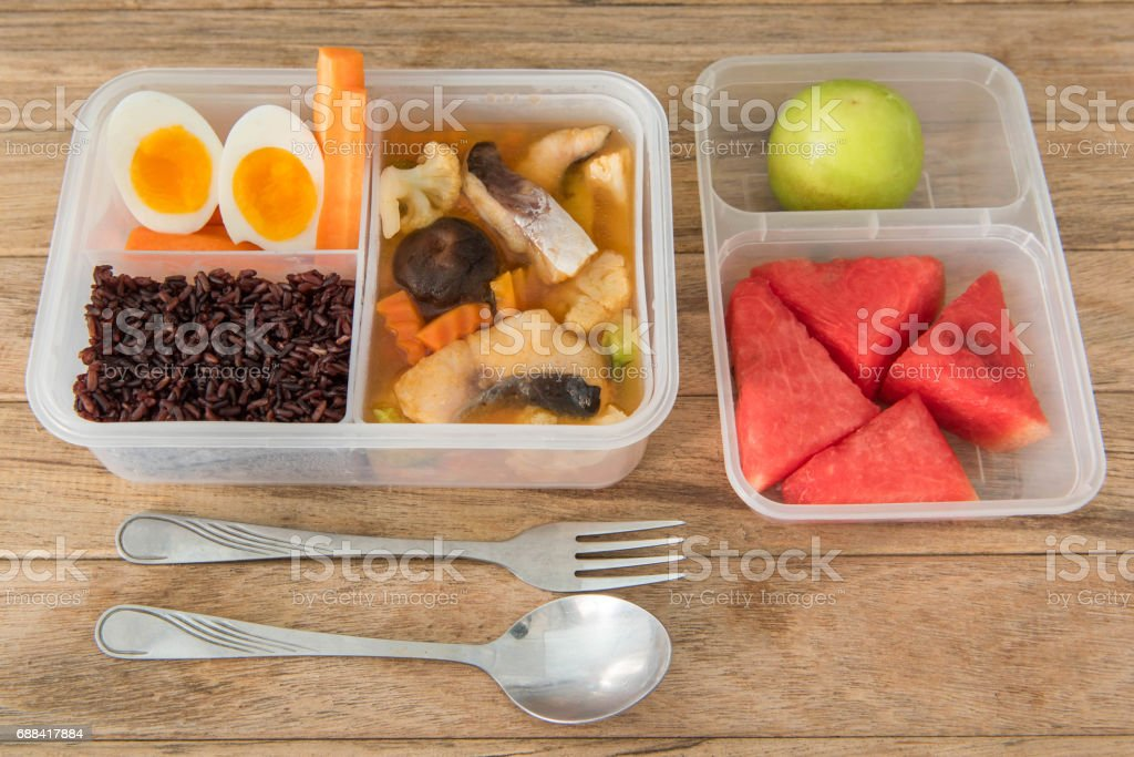 hot and sour curry with tamarind sauce, fish and vegetables, boiled egg in lunch box,Thai style food stock photo