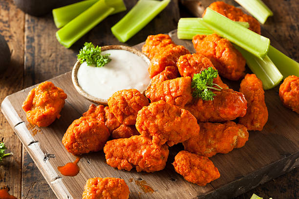 hot and spicy boneless buffalo chicken wings platter - animal wing stock photos and pictures