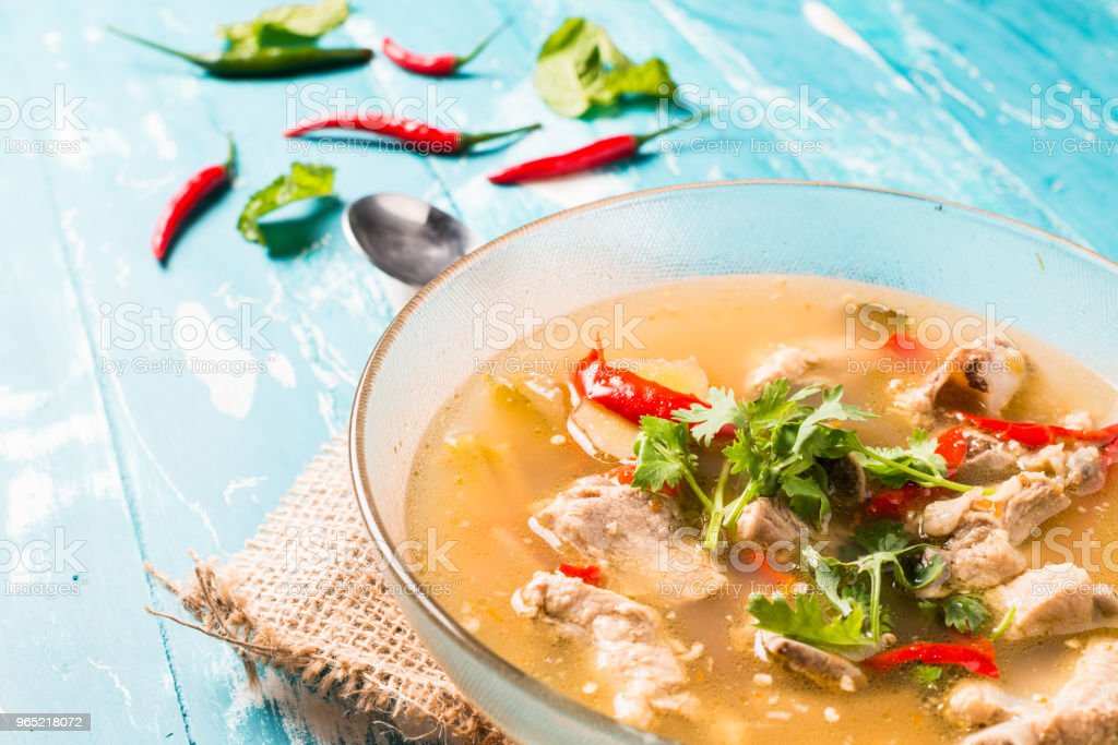 Hot and Spicy Soup with Pork Ribs on wooden background royalty-free stock photo