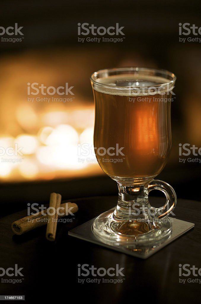 Hot Apple Cider by a Fireplace stock photo