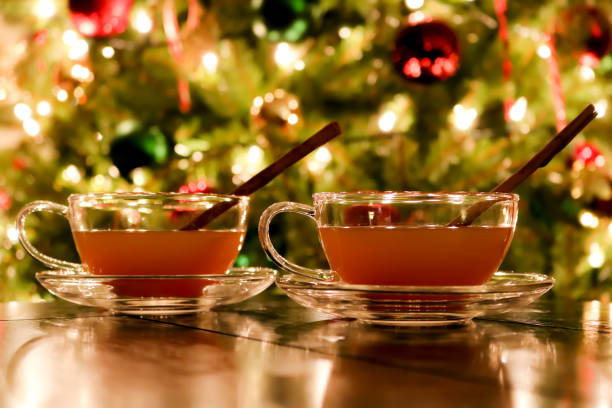 Hot Apple Cider by The Christmas Tree Holiday spiced bourbon apple cider by the Christmas tree allspice stock pictures, royalty-free photos & images