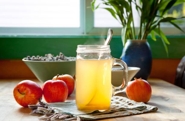 Hot apple cider vinegar and honey drink stock photo