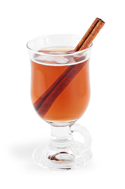 """Hot Apple Cider with Clipping Path """"Glass mug of hot apple cider with a cinnamon stick.  Isolated on white with clipping path.NB:  Clipping path might be available only for the largest size.  If the clipping path is important to you, please contact iStockphoto Support to find out their current policy for image sizes that include clipping paths."""" hot apple cider stock pictures, royalty-free photos & images"""