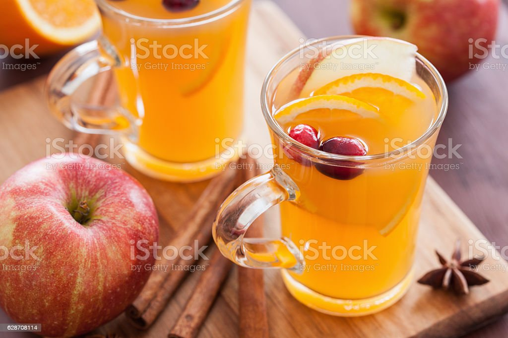 hot apple orange cider with cinnamon spice warming drink stock photo