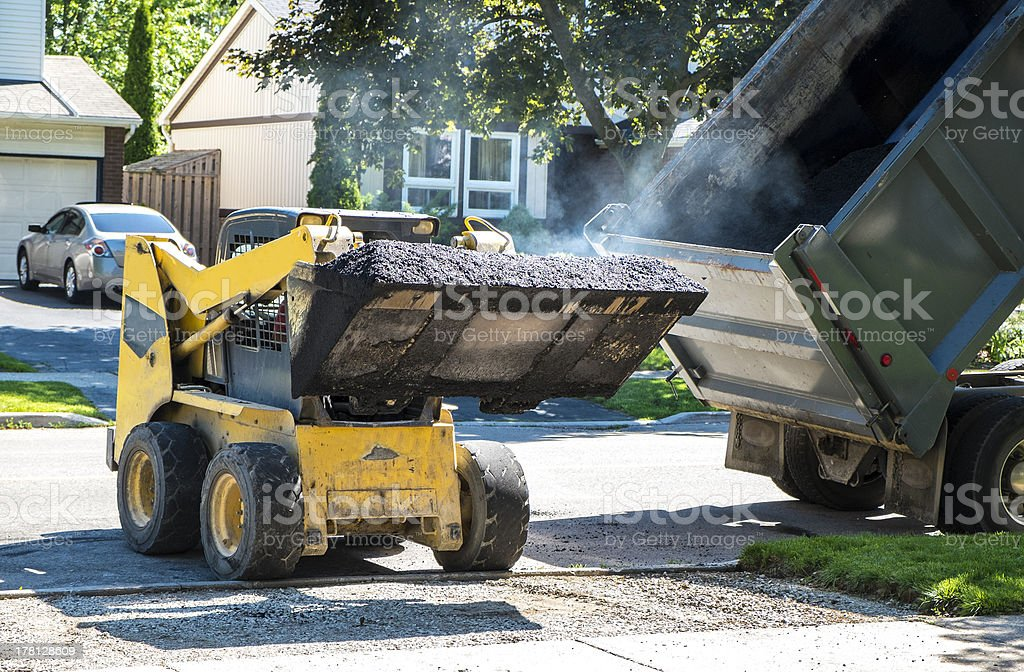 Hot Asphalt for Paving a Driveway royalty-free stock photo