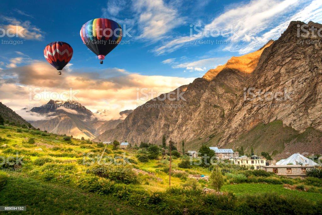 Hot balloon air over Jispa town, Lahaul valley, Himachal Pradesh, India. stock photo